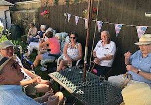 Family And Friends At Charity Tea Party