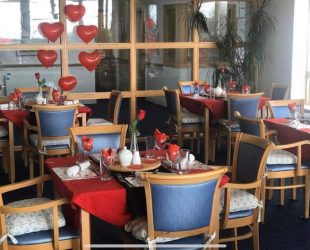 The Dining Room At Abbeyfield House Full Of Valentine's Treats
